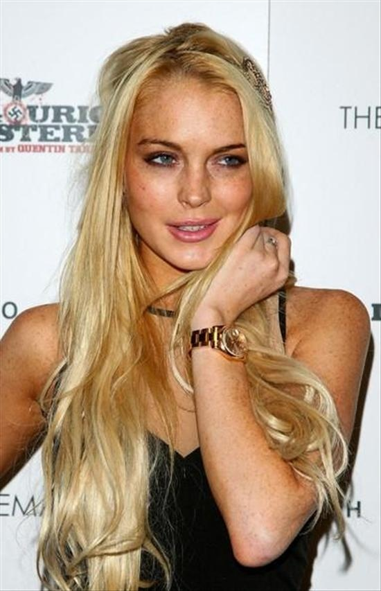 Over-sized men's Rolex watch wearer Lindsay Lohan may return to a Hackney cafe to complete her Community Service.